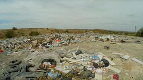 Unauthorized dump in a career outside the city. bird`s-eye view. Flight over unauthorized dump in a career outside the city. the camera takes a bird`s-eye view stock video footage
