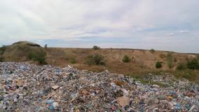 Unauthorized dump in a quarry near a road. bird`s-eye view. Flight over unauthorized dump in a quarry near a road. the camera takes a bird`s-eye view stock video footage