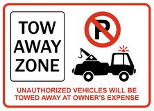 Unauthorized vehicles will be towed away at owners expense Stock Photo