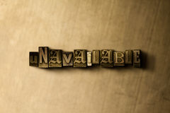 UNAVAILABLE - close-up of grungy vintage typeset word on metal backdrop Royalty Free Stock Image