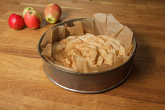 Unbaked apple pie on a table Stock Photo