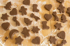 Unbaked gingerbread cookies on the plank table Stock Photo
