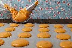 Unbaked orange macaroons Royalty Free Stock Photography