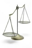 Unbalance of golden scales. Unbalance of golden brass scales of justice on white front perspective stock photography