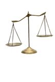 Unbalance scales. Unbalance of golden brass scales of justice on white stock photography