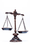 Isolated antique scale of justice (not balanced). Unbalanced scale of justice, represent crime Royalty Free Stock Photography