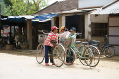 Unbalanced scene of children wih bicycle after school royalty free stock photography