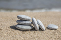 Unbalanced stones on beach Stock Photography
