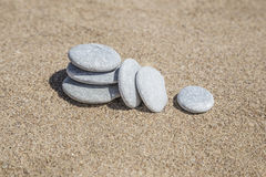 Unbalanced stones on beach Royalty Free Stock Image