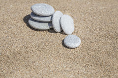 Unbalanced stones on beach Stock Photos