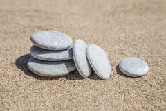 Unbalanced stones on beach Royalty Free Stock Photos