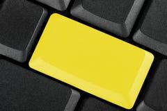 Unbelegte gelbe Taste Lizenzfreie Stockfotografie