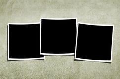 Unbelegte Polaroide über Weinlese-Hintergrund Stockfotos