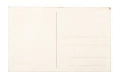 Unbelegte Postkarte über weißem Hintergrund. Lizenzfreies Stockfoto