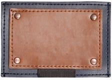 Unbelegte quadratische Formleder-Jeanskennsätze stockfoto