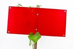Unbelegte rote Zeichen trennten Weiß Stockbild