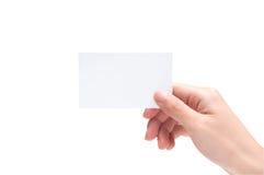 Unbelegte Visitenkarte in der Hand Lizenzfreie Stockfotografie