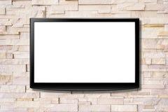 Unbelegter Bildschirm LCD-Fernsehapparat, der an einer Wand hängt Stockfotos