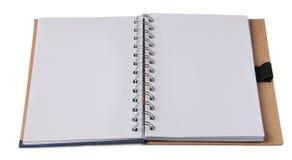 Unbelegter Notizblock auf Weiß Stockfotografie