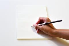 Unbelegtes Notizbuch mit Bleistift Lizenzfreie Stockbilder