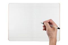 Unbelegtes Notizbuch von bereiten Papier mit Handholdin auf Lizenzfreie Stockfotografie