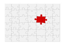 Unbelegtes Puzzle mit rotem Stück - XL Lizenzfreies Stockfoto