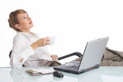 Unbelievable. Businesswoman relaxing in her office royalty free stock photos
