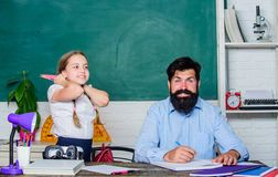 It is unbelievable. daughter study with father. Teachers day. knowledge day. Home schooling. back to school. Private. Teaching. private lesson. small girl child royalty free stock photo