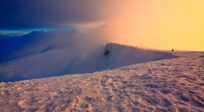 Unbelievable day on the snowy hill from the life of freerider. Mountains in fog. Morning lights. Fantastic winter scenery. Unbelievable day on the snowy hill royalty free stock photo