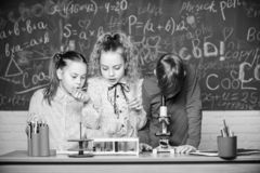 It is unbelievable. Little children at laboratory. Little kids learning chemistry in school lab. students do biology royalty free stock photography