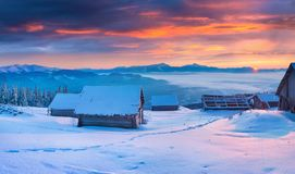 Unbelievable winter sunrise in mountain village. Stock Photography
