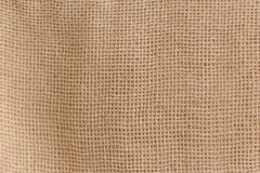 Unbleached calico cotton textile texture. Fabric background Royalty Free Stock Image