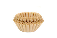 Unbleached coffee filters. A stack of unbleached coffee filters on white Royalty Free Stock Images