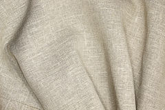 Unbleached fabric. With folds as gray background Royalty Free Stock Photo
