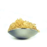 Unbleached sugar. Closeup unbleached sugar on teaspoon Stock Image