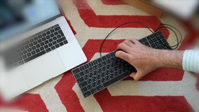 Unboxing new Apple keyboard computer laptop. London, United Kingdom - Apr 15, 2018: Man unboxing installing charging connecting new Magic Keyboard with Numeric stock video footage