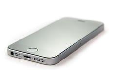 Unboxing och första körning av den nya iPhoneSEN Royaltyfri Bild