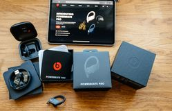 Unboxing of Powerbeats Pro Beats by Dr Dre wireless headphones. Paris, France - Jun 17, 2019: Unboxing of Powerbeats Pro Beats by Dr Dre wireless high royalty free stock photo