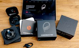 Unboxing of Powerbeats Pro Beats by Dr Dre wireless headphones. Paris, France - Jun 17, 2019: Unboxing of Powerbeats Pro Beats by Dr Dre wireless high royalty free stock photos
