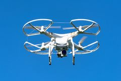 Unbranded unmarked photography drone with blue clear sky as background Royalty Free Stock Photos