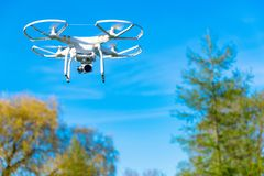 Unbranded unmarked photography drone in blue sky Stock Photography
