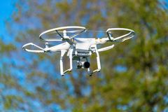 Unbranded unmarked photography drone with green tree background Royalty Free Stock Image