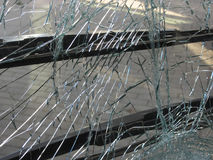 Unbreakable frontal glass damaged by crash in a public transport Stock Photos