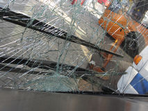Unbreakable frontal glass damaged by crash in a public transport Stock Image