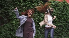 Unbridled joy of two redheaded girlfriends. girls fooling around, having fun, laughing and jumping. girlfriends having. Two redheaded girlfriends goofing around stock footage