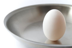 Unbroken Egg on a Pan Stock Photography