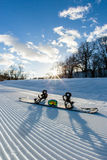Unbroken ski slope, snowboard and goggles. Unbroken ski slope, snowboard, goggles and cloudy sky Royalty Free Stock Images