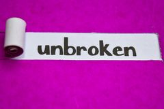 Unbroken text, Inspiration, Motivation and business concept on purple torn paper royalty free stock photos