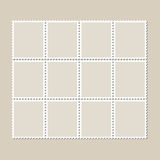 Unbroken vintage sheet of twelve postage stamps. Set of stamps on a light background with a shadow. Stock Photo