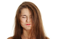 Unbrushed female teen making a face. Royalty Free Stock Photo